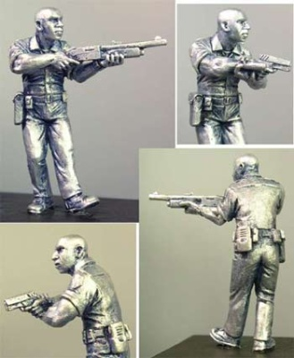 Ken.  Zombie hunter cop with Remington 870