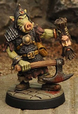 Orc Champion with axe and severed head